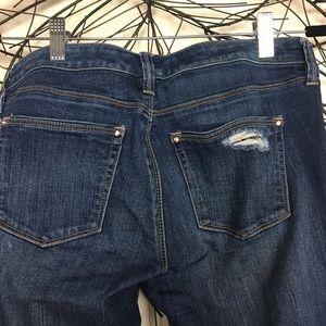 White House Black Market Jeans - Leopard print peak through distressed WHBM jeans.